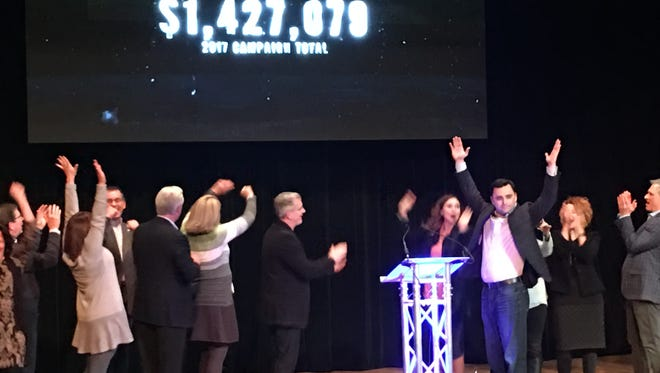 United Way of Delaware County campaign Chairman Casey Stanley (arms raised facing front) and campaign leaders celebrate surpassing the campaign goal of $1.2 million in an event Thursday night at Cornerstone Center for the Arts to announce campaign results and to thank volunteers. Donations totaled more than $1.4 million.