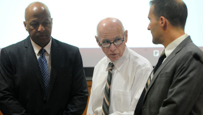 Senior Criminal Investigator Chas Wiggins, of the Ventura County Public Defender's Office, from left, Wilson Chouest and Chief Deputy Public Defender Andre Nintcheff, wait for the jury to come into Ventura County Superior Court during trial.