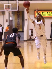 Midwestern State's Devante Pullum passes the ball in