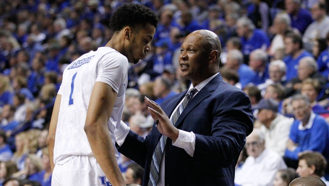 Feb 6, 2016; Lexington, KY, USA; Kentucky Wildcats assistant coach Kenny Payne talks with forward Skal Labissiere (1) during the game against the Florida Gators at Rupp Arena. Kentucky defeated Florida 80-61. Mandatory Credit: Mark Zerof-USA TODAY Sports