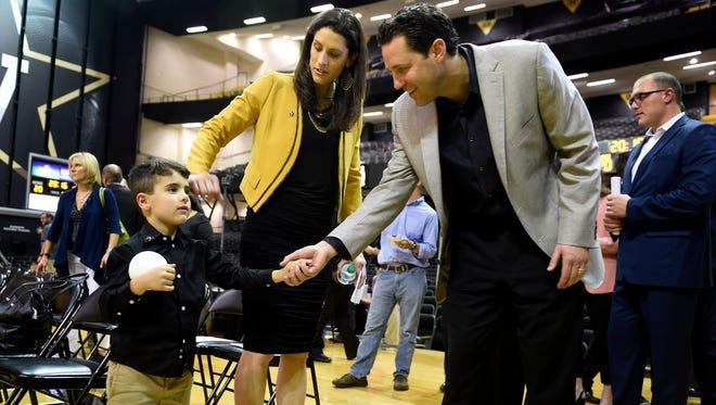 Vanderbilt men's basketball coach Bryce Drew greets Landon White 4, the son of the new Vanderbilt women's basketball coach Stephanie White after she was presented by the university at Memorial Gymnasium Wednesday May 25, 2016, in Nashville, Tenn.