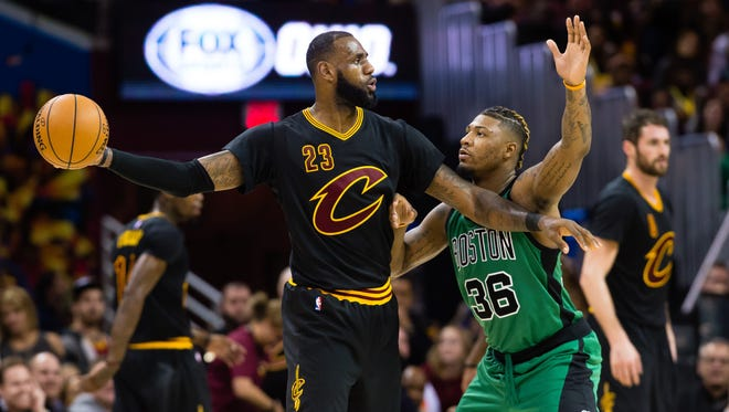 CLEVELAND, OH - DECEMBER 29: LeBron James #23 of the Cleveland Cavaliers looks for a pass while under pressure from Marcus Smart #36 of the Boston Celtics during the second half at Quicken Loans Arena on December 29, 2016 in Cleveland, Ohio. The Cavaliers defeated the Celtics 124-118. NOTE TO USER: User expressly acknowledges and agrees that, by downloading and/or using this photograph, user is consenting to the terms and conditions of the Getty Images License Agreement. Mandatory copyright notice. (Photo by Jason Miller/Getty Images) ORG XMIT: 662354023 ORIG FILE ID: 630662646
