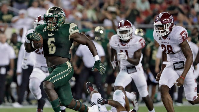 South Florida running back Darius Tice outruns the Temple defense on a 47-yard touchdown run during the first half.