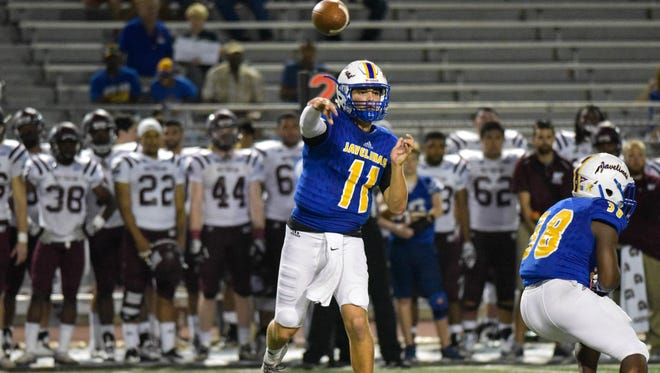 A&M-Kingsville's Cade Dyal passes the ball against West Texas A&M on Saturday, October 7, 2017 at Javelina Stadium in Kingsville.