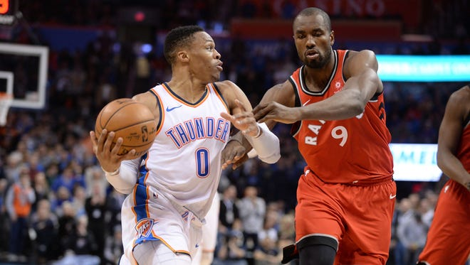 Russell Westbrook drives to the basket in front of Toronto Raptors forward Serge Ibaka.