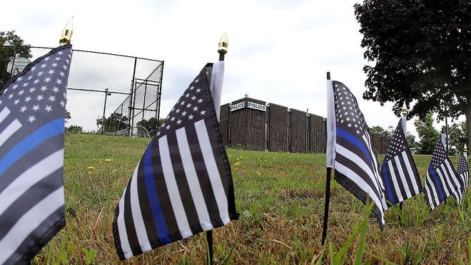 Police support flags surround the Braintree Police Department. Greg Derr/The Patriot Ledger