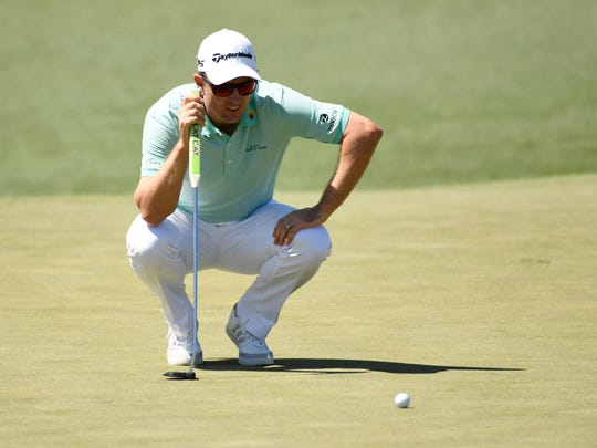 Justin Rose lines up a putt on the 2nd green during the third round of The Masters golf tournament at Augusta National Golf Club.