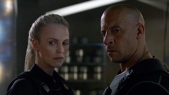Charlize Theron and Vin Diesel have a meeting of minds (and lips) in 'The Fate of the Furious.'