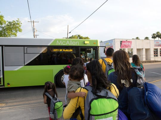 Immigrant families, many of them mothers with children, board a bus headed to McAllen, Texas.