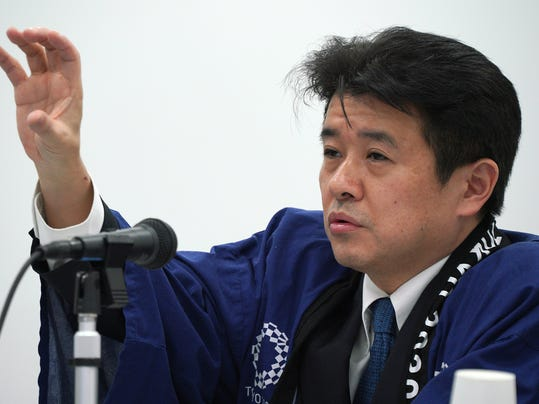 Hidemasa Nakamura, chief financial officer of the Tokyo 2020 Games, speaks on the updated version of the Games budget during a press conference in Tokyo Friday, Dec. 22, 2017. The latest price tag for the 2020 Tokyo Olympics has been trimmed slightly, but is still nearly twice the initial estimate even after a major cost-cutting effort. The organizers said Friday that the event will cost a total 1.35 trillion yen ($11.9 billion). (AP Photo/Eugene Hoshiko)