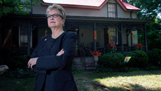 Blair Morgan stands in front of the Spring Hill home she grew up in on July 25.