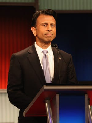 """Presidential candidate Louisiana Governor Bobby Jindal looks on during the """"undercard"""" Republican presidential debate."""