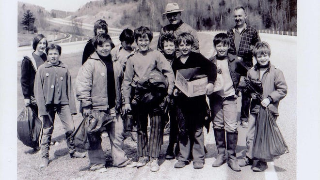 Former Gov. Deane Davis stands on Interstate 89 with a group of Cub Scouts, including Steven Drebber (in striped pants), on Vermont's first Green Up Day, in 1970.