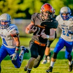 Charlotte's Justin Anderson ,center,  rushed for two touchdowns and had three interceptions Friday while helping the Orioles pick up their first win since Week 3 of the 2015 season.