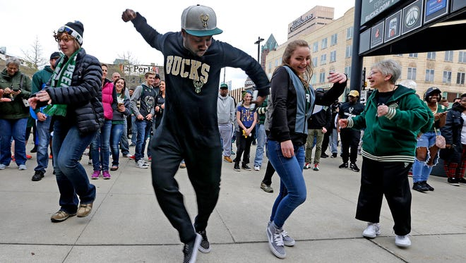 """""""I love dancing,"""" says Travis Henderson of Milwaukee as he gets pumped up during a pep rally before game three of the series between the Bucks and the Raptors."""