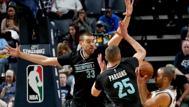 Memphis Grizzlies Marc Gasol and Chandler Parsons defend San Antonio Spurs Tony Parker at FedExForum.