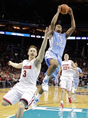 North Carolina's Kennedy Meeks goes up to dunk against Davidson's Brian Sullivan during the second half Saturday in Charlotte, N.C. North Carolina won 90-72.