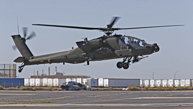A Boeing AH-64E Apache attack helicopter lands after a maintenance test flight at the Boeing manufacturing facility in Mesa on March 9, 2016.
