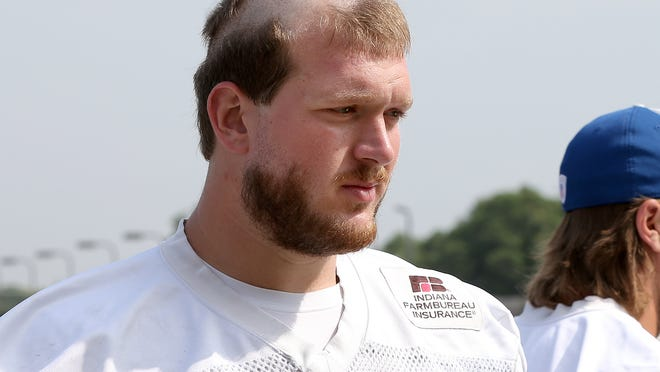 """Rookie offensive tackle Matt Hall shows off his """"Rookie Hair Cut"""" during the Indianapolis Colts training camp Tuesday, August 5, 2014, afternoon on the Anderson University campus."""