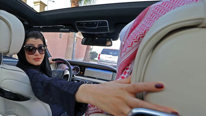 In this file photo taken on April 29, 2018, a Saudi woman practices reversing a car in Riyadh ahead of the lifting of a ban on women driving in Saudi Arabia in the summer.