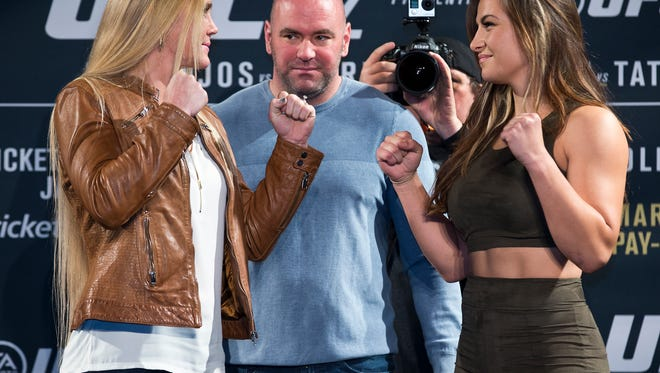 Holly Holm, left, and Miesha Tate will meet Saturday in Las Vegas in UFC 196.
