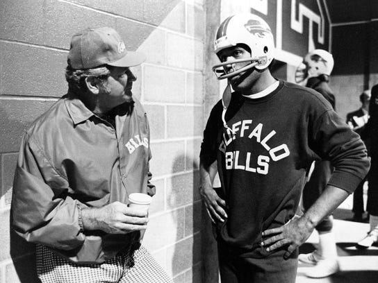 O.J. Simpson talks with Bills coach Jim Ringo before a workout at Rich Stadium in Buffalo, N.Y., in this Sept. 12, 1976 photo.
