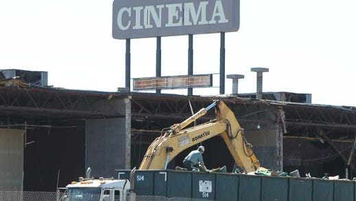 A truck driver sorts through debris from the demolition of Showcase Cinema in Erlanger in September 2015 before leaving the site.