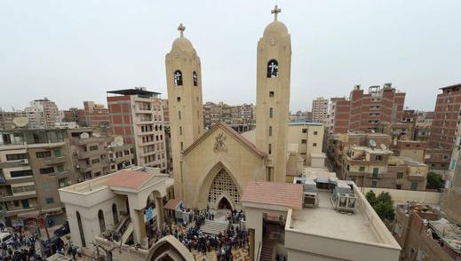 People gather outside the Mar Girgis Coptic Church in the Nile Delta City of Tanta, 75 miles north of Cairo, after a bomb blast struck worshippers gathering to celebrate Palm Sunday on April 9, 2017.