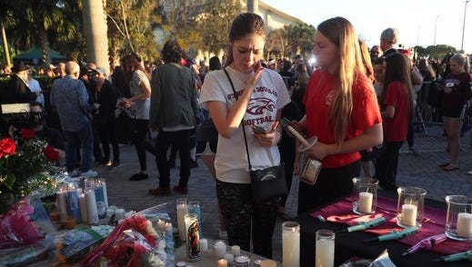Scene from the candlelight vigil Thursday at City of Parkland ampitheater in honor of those slain and injured in the school shooting.