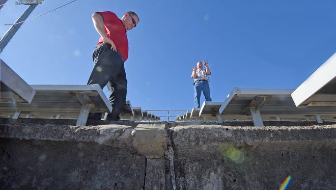 Shelby Schools Assistant Superintendent Paul Walker and Building Maintenance, Grounds and Safety Director Scott Harvey examine the deteriorating steps at the football stadium at W.W. Skiles Field in October.