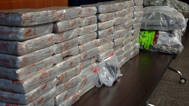 A gun and part of the $2 million and 154 pounds of heroin that DEA officials say passed through Montville on its way to Bronx, N.Y.