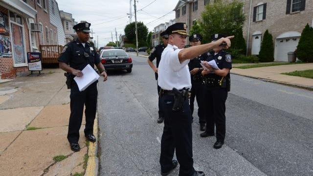 Wilmington Police Capt. Bill Browne directs officers at Ninth and Du Pont Streets near St. Anthony of Padua.