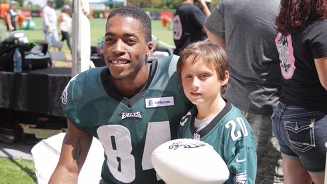 Former UD receiver Mike Johnson poses with Danny Feltwell at Philadelphia Eagles camp Wednesday.