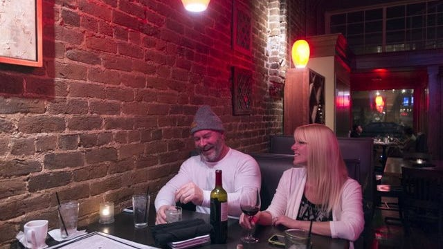 Downtown Knoxville residents Gregg and Vania Thompson have drinks at Cru Bistro & Wine Bar.