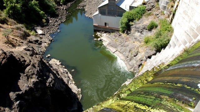 In this Aug. 21, 2009 file photo, water trickles over Copco No. 1 Dam on the Klamath River outside Hornbrook, California. The dam is one of four slated for removal under a Klamath River Renewal Corp. proposal.