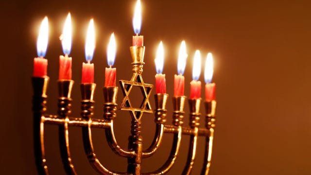 Candles lit for the eighth night of Hanukkah.