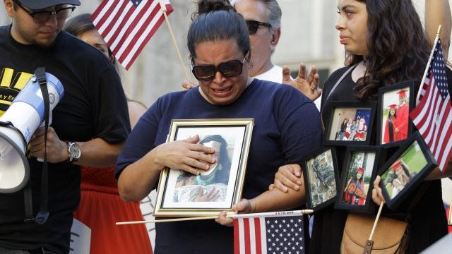 Ericka Chaves, center, whose daughter Natalie Romero, 20, is recovering after sustaining injuries when a car plowed into a crowd in Charlottesville, Va., stands in front of a crowd at a solidarity vigil at City Hall, Sunday, Aug. 13, 2017, in Houston. Romero attends the University of Virginia.