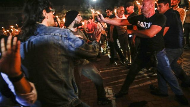 """Multiple white nationalist groups march with torches through the UVA campus in Charlottesville. When met by counter protesters, some yelling """"Black lives matter,"""" tempers flared into violence. Multiple punches were thrown, pepper spray was sprayed and torches were used as weapons."""