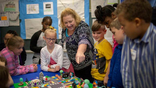 Mt. Pleasant Elementary School Principal Julie Tidwell reviews a layout for a new city sidewalk created by students at the elementary school on on Friday, March 13, 2020. She is joined by Mason McMaham 8, to her left and Katie Bozeman, 8, to her right.