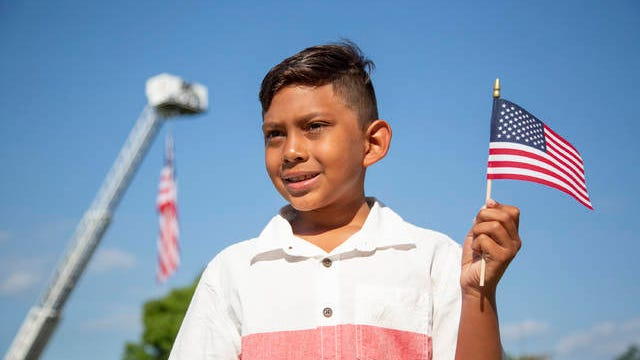 Marvin Wright Elementary School student Jacob Polanco, 9, poses during an Independence Day celebration at Riverwalk Park in Columbia on Thursday, July 4, 2019. He was chosen to lead the parade after winning an essay contest on patriotism.