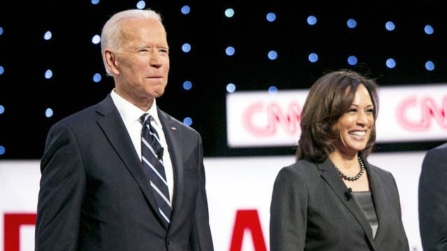 Former Vice President Joe Biden and Sen. Kamala Harris, D-Calif., stand together during of the Democratic presidential candidate debate in 2019.