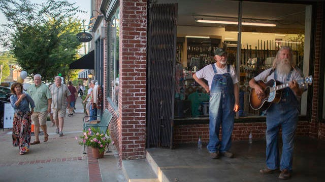 Charlie Halfner and Mike Neal play country standards on the steps of Ted's Sporting Goods in Columbia during the city's First Friday event on Friday, Sept. 6, 2019.