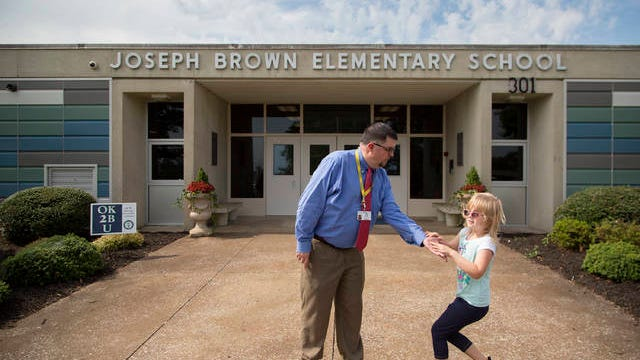 Joseph Brown Elementary School Principal Robert Busch welcomes McCartney Compton during the first day of classes for Maury County Public Schools on Thursday, Aug. 1, 2019.