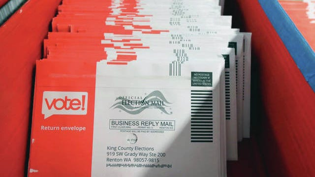 Mail-in ballots sit, ready to process in Renton, Wash.