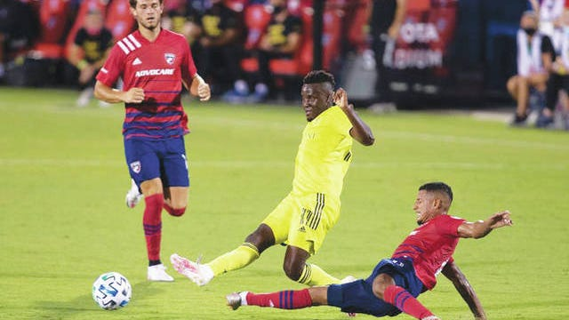 Nashville SC forward David Accam (11) shoots on goal as FC Dallas forward Fafa Picault (9) attempts to deflect the shot.