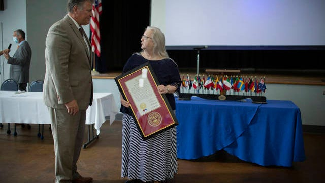 """Rep. Scott Cepicky, R-Columbia, speaks with Mary Anne Hill Balcer after being recognized for inspiring the launch of the """"Where's Baby?"""" campaign inside the Memorial Building in Columbia, Tenn., on Friday, Aug. 14, 2020."""