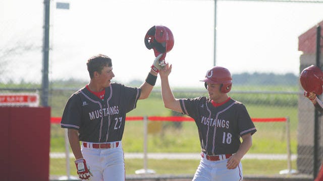 DCG seniors Cody Hall and Logan Smith celebrating after scoring a run Thursday, June 25. PHOTO BY ANDREW BROWN/DALLAS COUNTY NEWS