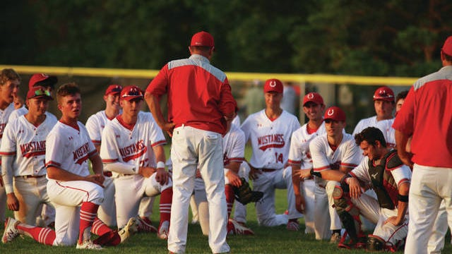 DCG baseball head coach Byron Peyton addresses his team following their 15-1 postseason-opening win over Greene County Friday, July 17. PHOTO BY ANDREW BROWN/DALLAS COUNTY NEWS