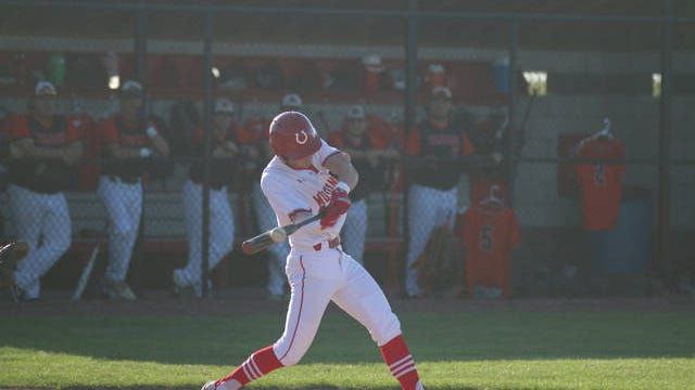 DCG senior Bryce Jermier takes a cut at a pitch Monday, July 20 against Carroll in the Substate 8 semi-final in Dallas Center. PHOTO BY ANDREW BROWN/DALLAS COUNTY NEWS