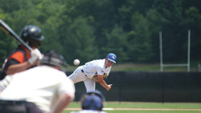 Van Meter's Anthony Potthoff pitches during a home game earlier this season. PHOTO BY ANDREW BROWN/DALLAS COUNTY NEWS